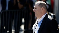 Cuffed Weinstein taken to court after being charged with rape