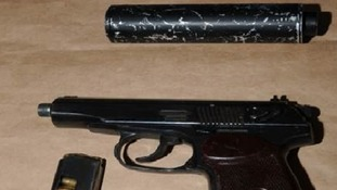 The firearm and silencer which were seized.