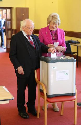 President Michael D Higgins and his wife Sabina cast their votes at the polling station in St Mary's Hospital, Phoenix Park, Dublin.