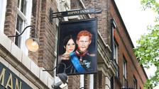 Pub celebrates new royal couple with portrait swing sign
