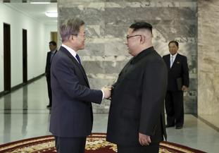 North Korean leader Kim Jong Un and South Korean President Moon Jae-in shake hands before their meeting at the northern side of Panmunjom in North Korea.