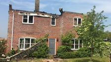 House fire caused by lightning completely destroys roof