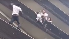 Real life 'Spider-Man' rescues dangling boy in Paris