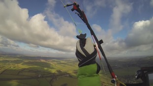 Paraglider looks down over Wiltshire