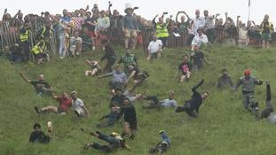 Cheese Rolling Race champion savours victory in downhill dash but won't be eating his prize