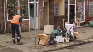 Businesses have been forced to throw out items damaged by the water