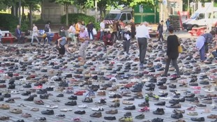 Thousands of shoes laid out in European square
