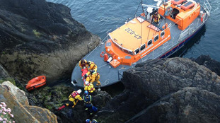 Rescue teams save teenager after falling from cliff on Isle of Man