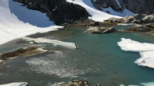 Skier takes 'water skiing' to the next level with impressive stunt