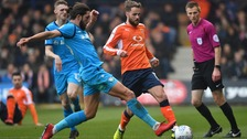 Andrew Shinnie is staying with Luton Town.