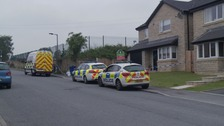 Police guard scene where woman's body was found