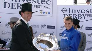 Charlie Appleby (left) celebrates alongside jockey William Buick (right).