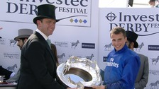 Charlie Appleby (left) celebrates alongside jockey William Buick (right).