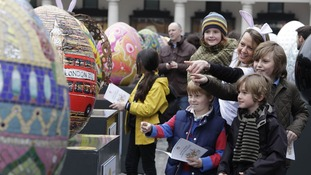 People admiring the eggs.