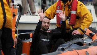 Protester halts eventful boat race