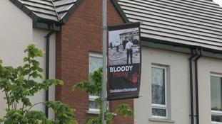 Call for IRA atrocity banners to be removed from shared housing estate Cantrell Close in south Belfast