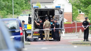 Two men held under the Terrorism Act after bomb disposal officers called to house in Greater Manchester