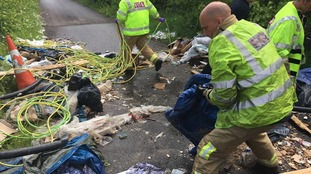 Firefighters forced to clear flytipped rubbish blocking route to five-car crash
