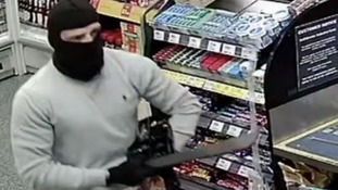 Greater Manchester Police have released CCTV images of an armed robbery in Bury