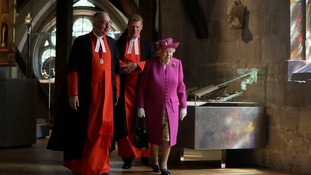 The Queen walks through the Queen's Diamond Jubilee Galleries at Westminster Abbey.