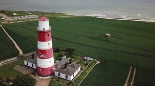 The 85-ft Happisburgh lighthouse has stood on the Norfolk coast since 1791.