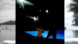 Royle's former girlfriend submitted video of him dancing and swimming in the pool.
