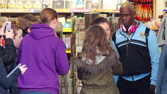 Mario Balotelli with fans at Stockport Train Station.