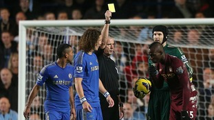 Balotelli booked for simulation during a clash with Chelsea