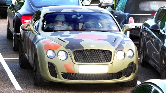 Balotelli out in Cheshire in his camouflaged Bentley car