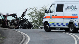 Police at the scene of a fatal car crash on the A614, East Yorkshire where three people died
