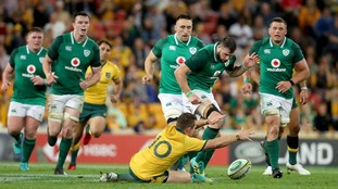 Ireland's Robbie Henshaw and Australia's Bernard Foley in action