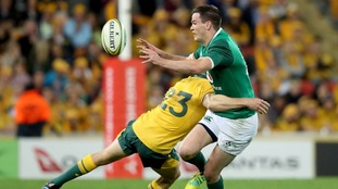 Ireland's Johnny Sexton is tackled by Australia's Reece Hodge