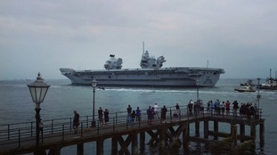 Crowds turn out to see navy's flagship leave Portsmouth