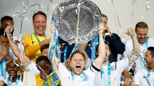 Olly Murs lifts the Soccer Aid trophy.