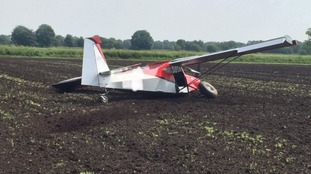 Lucky escape for two men after plane crashes in field
