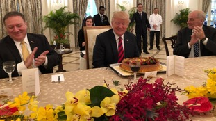 At the lunch with Mr Lee, President Trump was presented with a cake ahead of his birthday on Thursday.