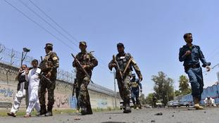 Suicide bomber strikes outside Kabul government offices