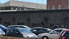 A man climbed on to the perimeter wall