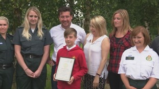 10-year-old boy receives award for saving his mum after she collapsed