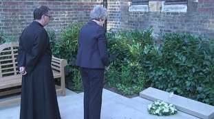 The prime minister paused in reflection after placing the wreath.