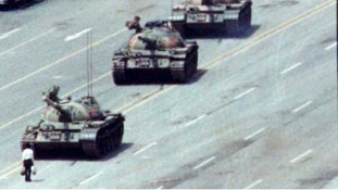 A Beijing citizen stands in front of tanks on the Avenue of Eternal Peace in this June 5, 1989