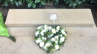 The floral wreath and written tribute.