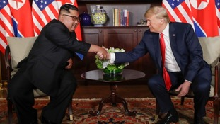 U. S. President Donald Trump shakes hands with North Korea leader Kim Jong Un during their first meetings at the Capella resort on Sentosa Island Tuesday, June 12, 2018 in Singapore.