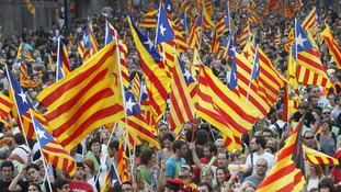 Marchers wave Catalonian nationalist flags during a celebration in Barcelona in September 2012
