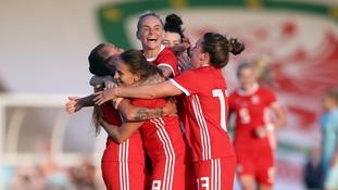 Natasha Harding (left) celebrates scoring Wales' third goal against Russia.
