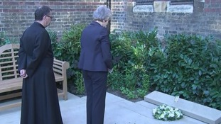 The prime minister paused in reflection after placing a wreath outside St Clement's Church.