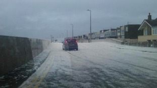 The foam spilling over the sea wall at Cleveleys.