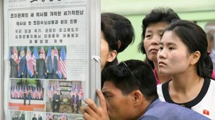 North Koreans read about Kim Jong-un's successes in Singapore.