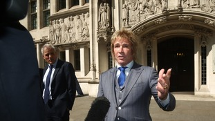 Pimlico Plumbers chief executive Charlie Mullins leaves the UK Supreme Court,