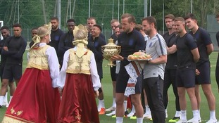 Harry Kane clutches a traditional Russian teapot.